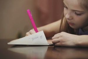 40260445 - a girl writes a letter to the desire