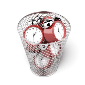 23440176 - alarm clocks in the trash isolated on a white background? 3d render